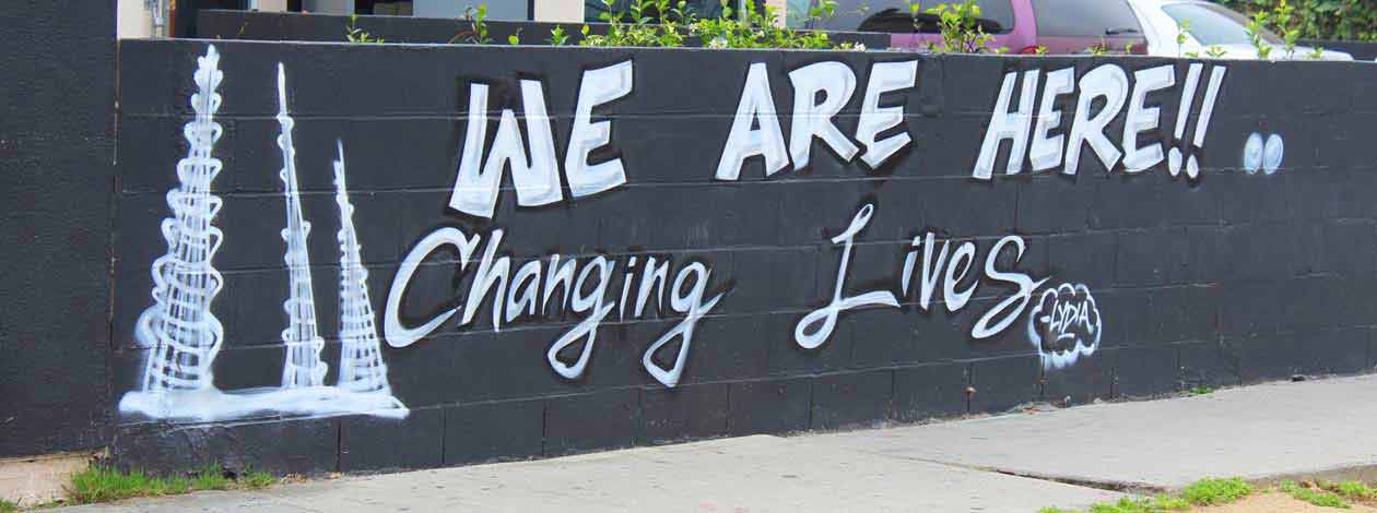 We are here changing lives wall